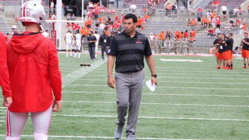 Ryan Day coaching quarterbacks during pregame warmups.