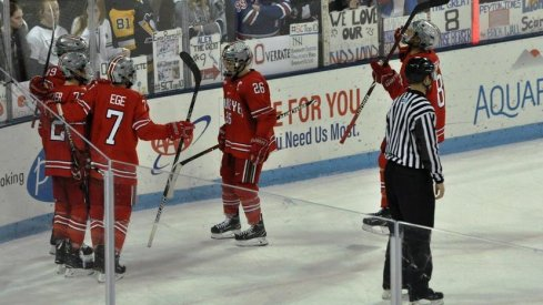 The men's hockey Buckeyes celebrate a goal in a 6-4 win over the Penn State Nittany Lions