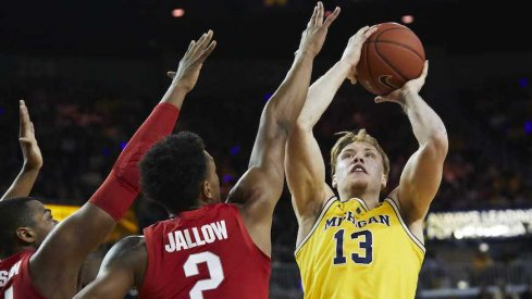 Ignas Brazdeikis shoots over Ohio State's Kaleb Wesson and Musa Jallow