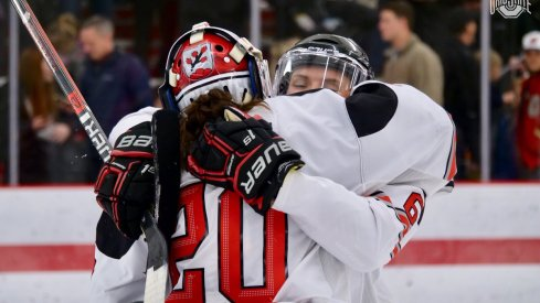 It is possible Andrea Braendli has mistaken Lauren Boyle for a puck in need of stopping. Or it's a hug.