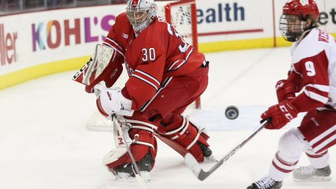 Buckeye goalie Sean Romeo battles the Wisconsin Badgers in a 2-1 overtime victory.