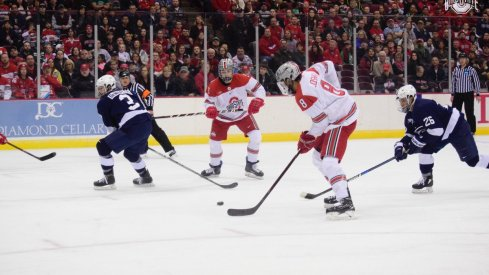 Ohio State's Dakota Joshua connects with a pass in the Big Ten Hockey semifinals against Penn State.