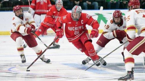 Buckeye captain Mason Jobst splits the Denver defense in the West Regional of the 2019 NCAA men's hockey tournament.