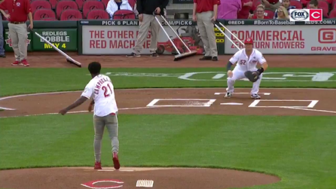 Parris Campbell tosses the opening pitch of the Reds vs. Marlins game.