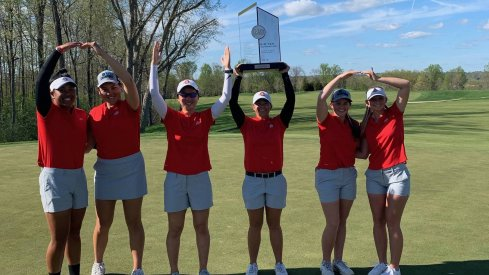 Women's golf celebrates its Big Ten title.
