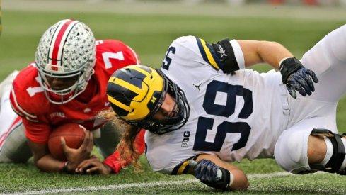 Nov 24, 2018; Columbus, OH, USA; Ohio State Buckeyes quarterback Dwayne Haskins (7) tackled by Michigan Wolverines linebacker Noah Furbush (59) during the first half at Ohio Stadium. Mandatory Credit: Joe Maiorana-USA TODAY Sports