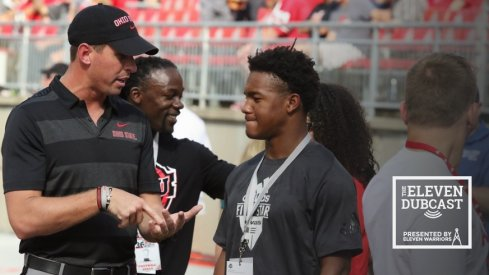 Coach Brian Hartline with a recruit