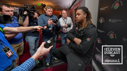 Ohio State defensive lineman Chase Young, surrounded by reporters