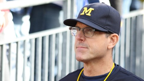 Jim Harbaugh takes a swipe at Urban Meyer