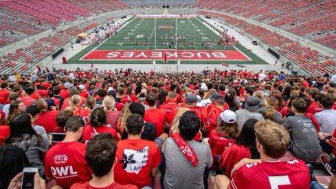 Ohio State students watch practice inside Ohio Stadium.