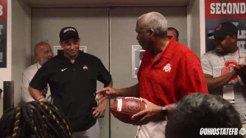 Gene Smith gives Ryan Day the game ball.