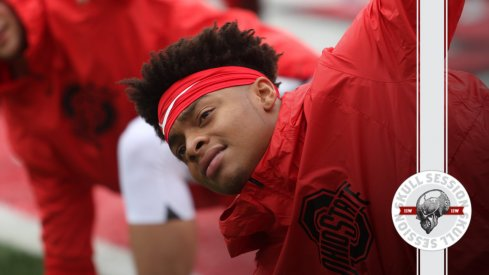 Justin Fields is stretching in today's skull session.