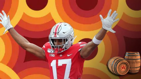 Sep 21, 2019; Columbus, OH, USA; Ohio State Buckeyes wide receiver Chris Olave (17) scores a touchdown as he is lifted by Ohio State Buckeyes offensive lineman Thayer Munford (75) during the first half against the Miami (Oh) Redhawks at Ohio Stadium. Mand