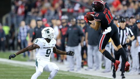 Austin Mack hauls in a back-shoulder fade to convert a third down against the Spartans.
