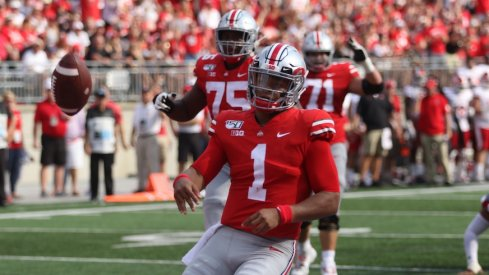 Justin Fields celebrates after running for a touchdown.