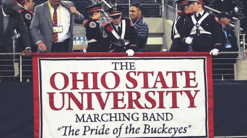 Members set up the Marching Band banner.
