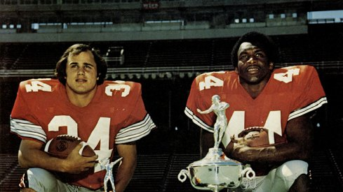 Running backs Jeff Logan and Archie Griffin pose with their trophies.