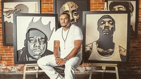 Percy King with a few of his art pieces.