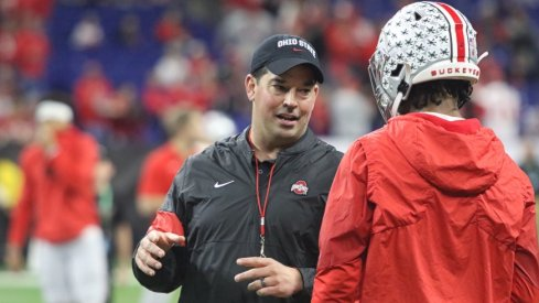 Ryan Day talking to an Ohio State football player