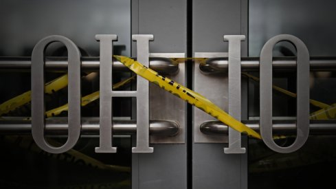 Caution tape was wrapped around the entrance to the Ohio Union on Tuesday, April 14, 2020, at Ohio State University after the campus closed in the spring and classes went online due to the COVID-19 pandemic.