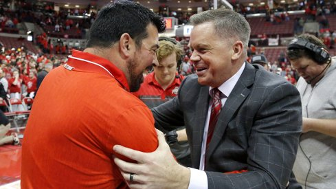 Ohio State football coach Ryan Day embracing Ohio State basketball coach Chris Holtmann