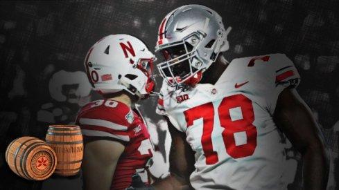 Ohio State tackle Nicholas Petit-Frere greets Nebraska safety Eli Sullivan