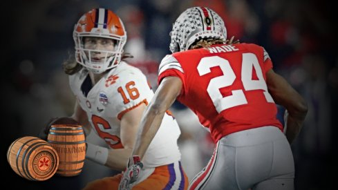 Dec 28, 2019; Glendale, AZ, USA; Ohio State Buckeyes cornerback Shaun Wade (24) tackles Clemson Tigers quarterback Trevor Lawrence (24) in the 2019 Fiesta Bowl college football playoff semifinal game at State Farm Stadium. Wade would be ejected from the game for targeting. Mandatory Credit: Mark J. Rebilas-USA TODAY Sports