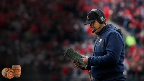 Michigan head coach Jim Harbaugh looks down at his notes during a timeout in the second half against Ohio State at Ohio Stadium in Columbus, Ohio, Saturday, Nov. 24, 2018. Jim Harbaugh