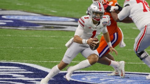 Justin Fields gets broken, then leads Ohio State on a record-breaking night