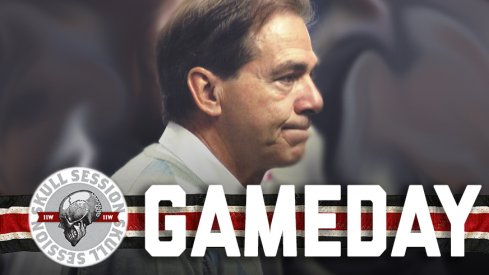 Nick Saban is getting put in a trashcan.