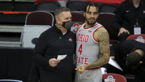 Chris Holtmann and Duane Washington Jr.