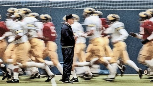 Bo Schembechler with his players during practice in October 1986 before the game that he won his 200th career victory. They are at the University of Michigan practice facility in Ann Arbor. Mary Schroeder Photos 28