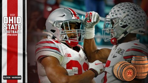 Jan 11, 2021; Miami Gardens, Florida, USA; Ohio State Buckeyes running back Master Teague III (33) celebrates with wide receiver Garrett Wilson (5) after scoring a touchdown during the first quarter against the Alabama Crimson Tide in the 2021 College Football Playoff National Championship Game.