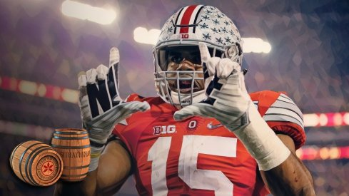 Ohio State Buckeyes running back Ezekiel Elliott (15) celebrates scoring a touchdown on a 33-yard run during the first quarter of the College Football Playoff National Championship against the Oregon Ducks at AT&T Stadium in Arlington, Texas on January 12, 2015.