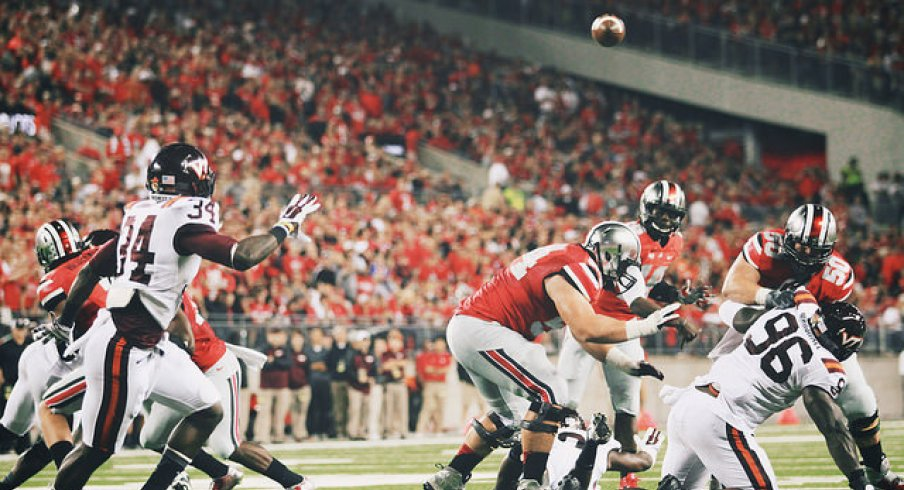 In this rare photo, J.T. Barrett has time to throw.