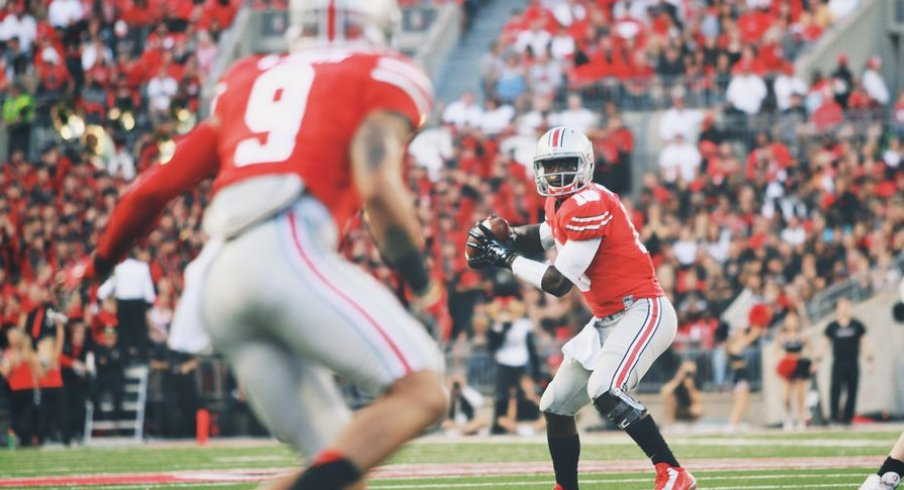 Four games into his collegiate career, J.T. Barrett is etching his name in the OSU record books.
