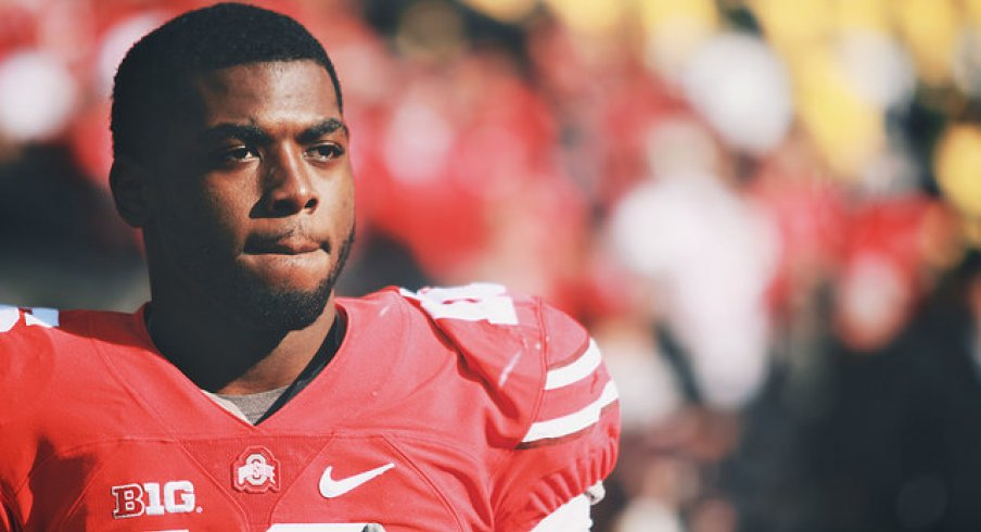 Ohio State beat arch rival Michigan and will play in the Big Ten title game next weekend, but a cloud hangs over Columbus with the loss of quarterback J.T. Barrett.