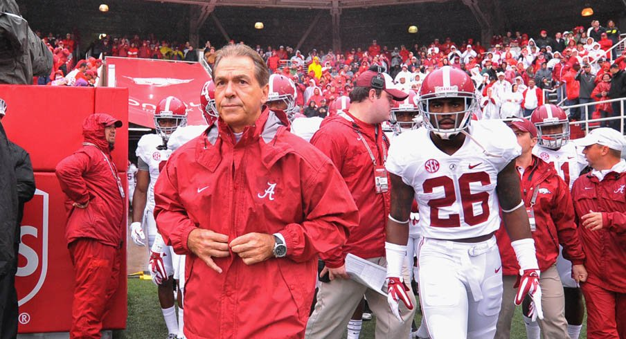 Alabama coach Nick Saban walks out on to the field with safety Landon Collins