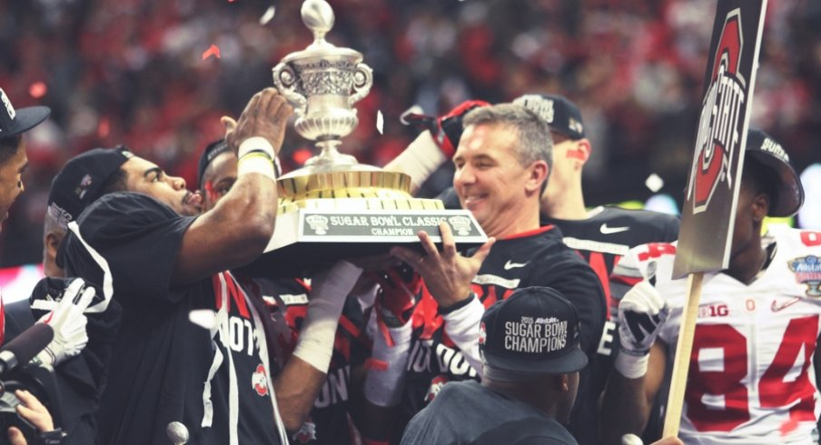 Sugar Bowl offensive MVP Ezekiel Elliott and head coach Urban Meyer hoist the Sugar Bowl hardware.