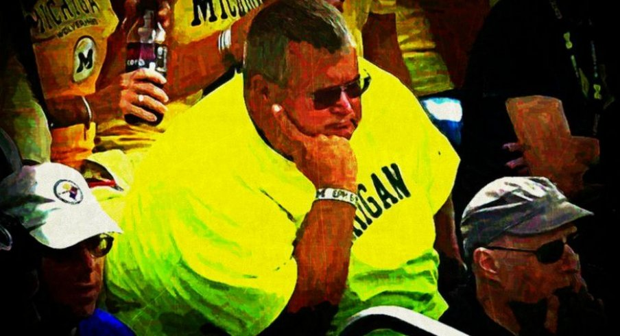 Michigan fans watching the Little Brown Jug slip away, 2014