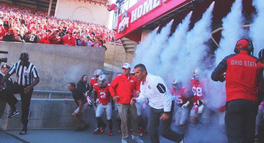 Urban Meyer, Ohio State take the field.