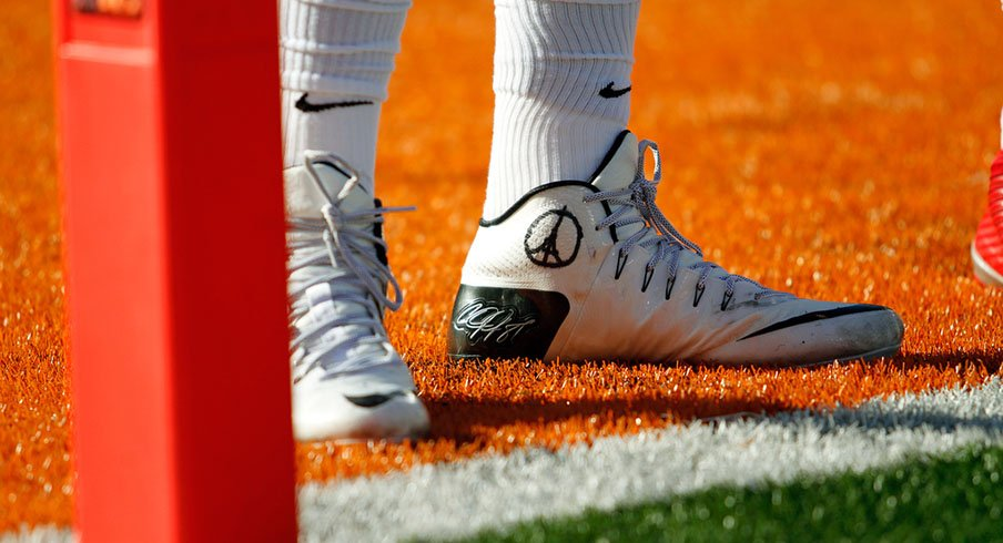 Cardale Jones' cleats for the Illinois game, in show of support for Paris.
