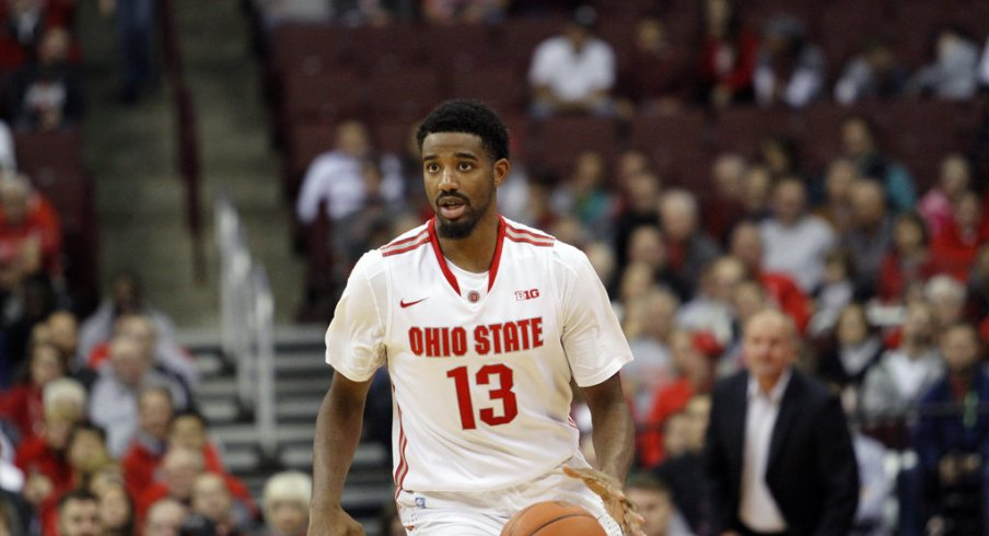 JaQuan Lyle brings the ball up the floor.