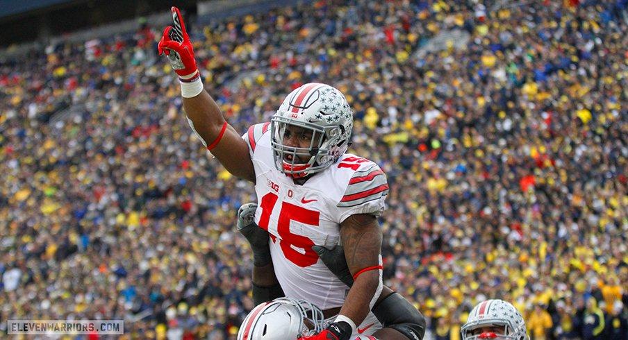 Ezekiel Elliott celebrates a touchdown run against Michigan.