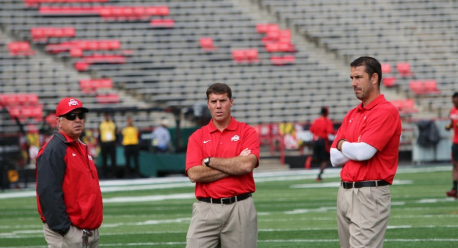 Tim Hinton, Chris Ash and Luke Fickell gathered on the field.