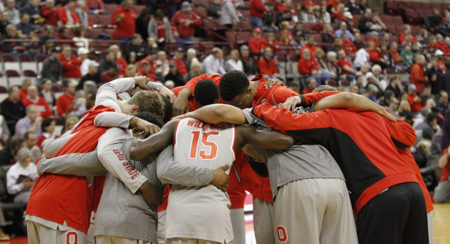 The Buckeyes huddle up before the tip against their rivals.