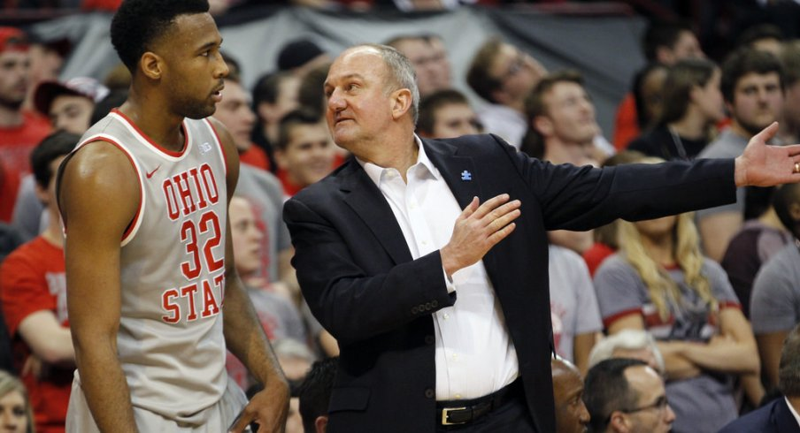 Thad Matta talks to Trevor Thompson during Tuesday's game against Michigan.