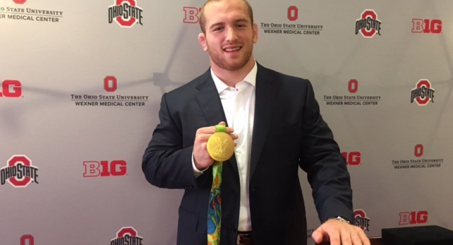 Kyle Snyder shows off his Olympic Hardware.