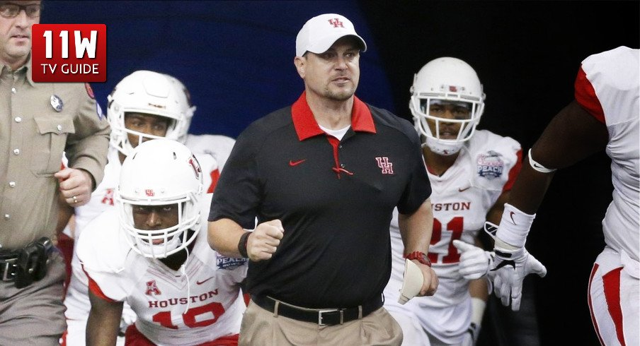 Tom Herman leads the Houston Cougars to the field for the Peach Bowl