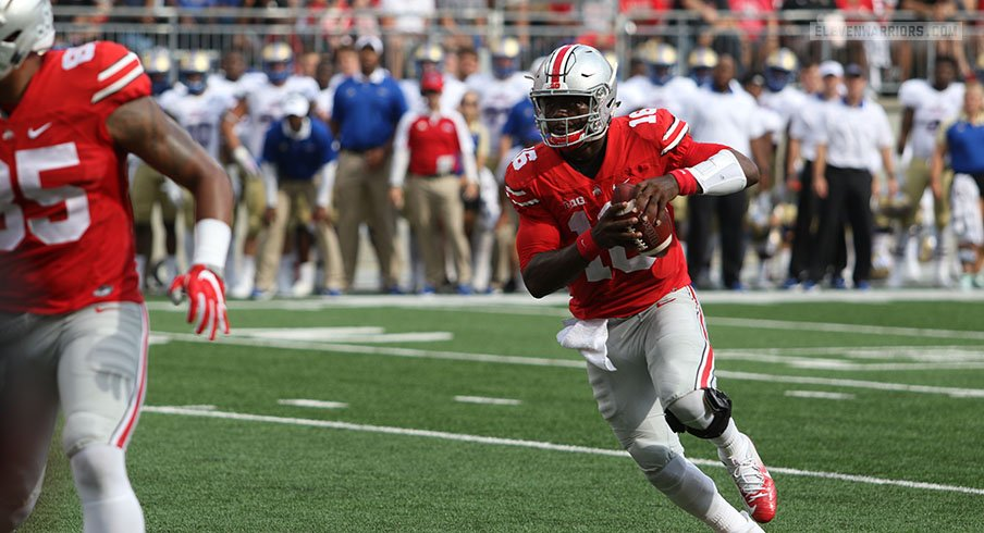 J.T. Barrett runs around for a short gain against Tulsa.